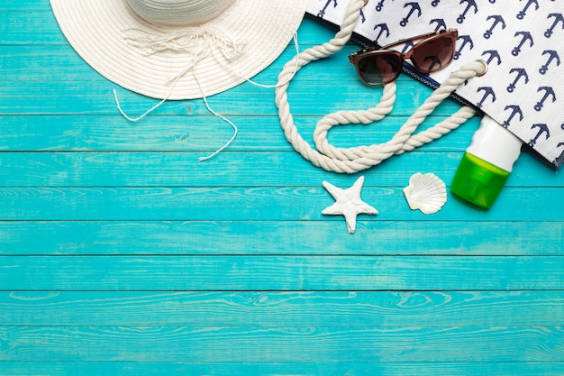 Beach accessories on wooden table.