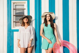 Beach and summer concept with women in front of wall
