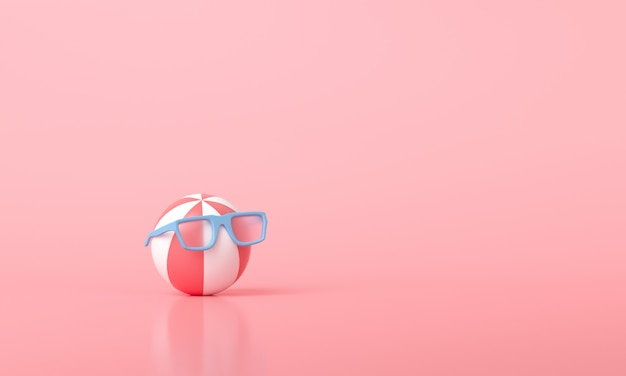 Beach ball wearing sunglasses on pink
