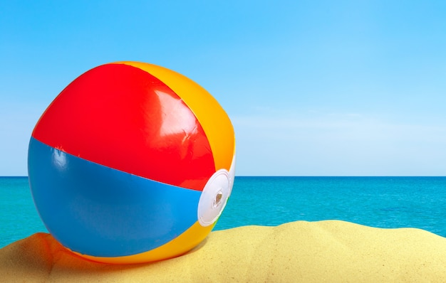 Beach ball on a white sandy