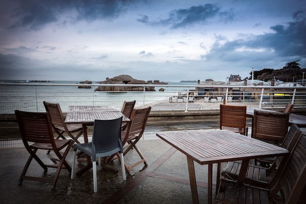 Beach cafe and view of the embankment of the city of trigastel.  north of france