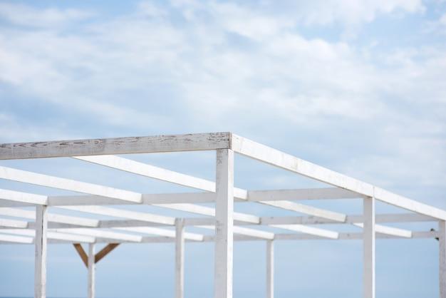 Beach canopy frame made of wooden slats