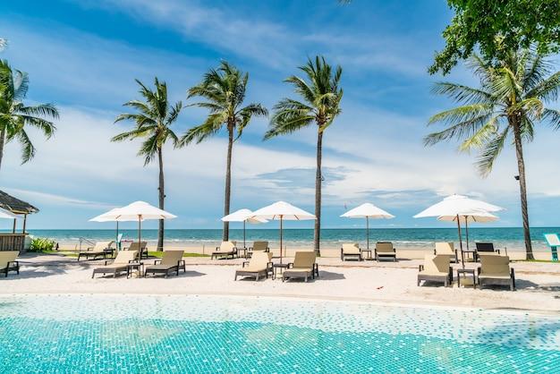 Beach chair around swimming pool in hotel resort
