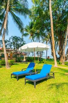 Beach chair in garden with sea