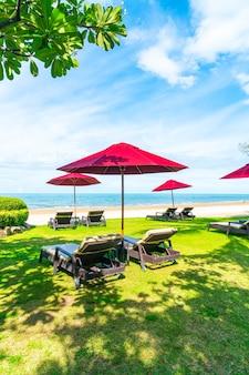 Beach chair and umbrella with ocean sea beach views