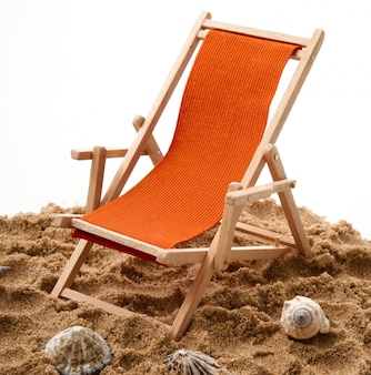 Beach chair with shellfish on white