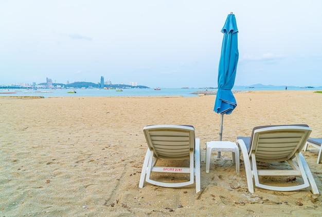 Beach chair with umbrella on sea beach at pattaya
