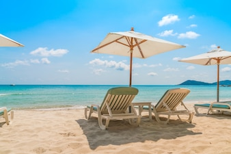 Beach chairs on tropical white sand beach