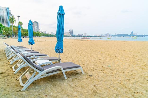 Beach chairs with umbrellas on the beach