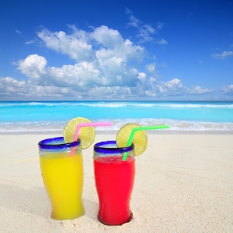 Beach cocktails yellow red in caribbean tropical sea