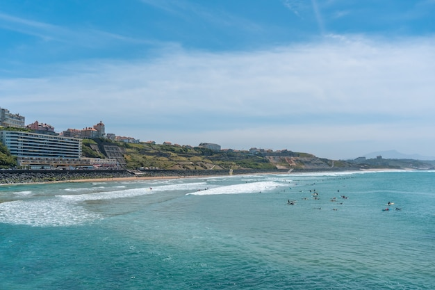 Beach cote des basques on a summer afternoon full of surfers