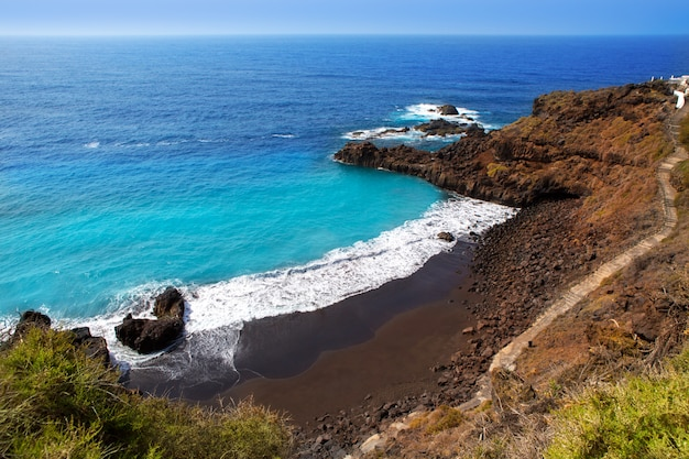 Beach el bollullo black brown sand and aqua water