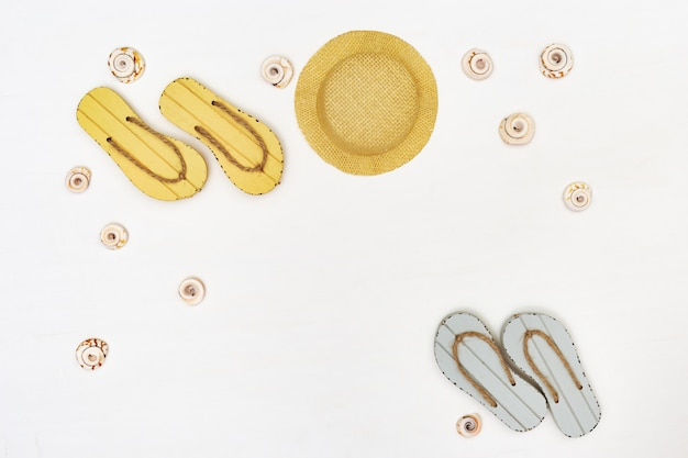Beach flip flops and straw hat. summer items on white background. summer concept. copy space.
