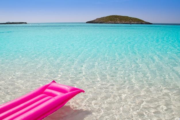 Beach floating lounge pink tropical sea formentera