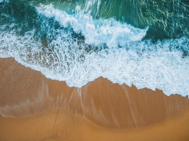 Beach full of rocks and waves in spain