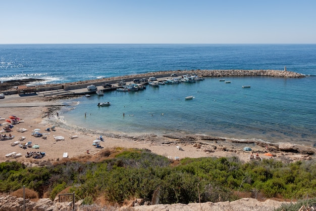Beach and harbour at cape deprano cyprus