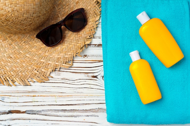 Beach hat and sunscreen bottle. vacation concept