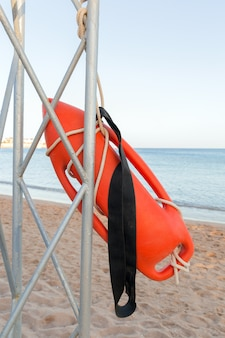 Beach life-saving. lifeguard tower with orange buoy on the beach.