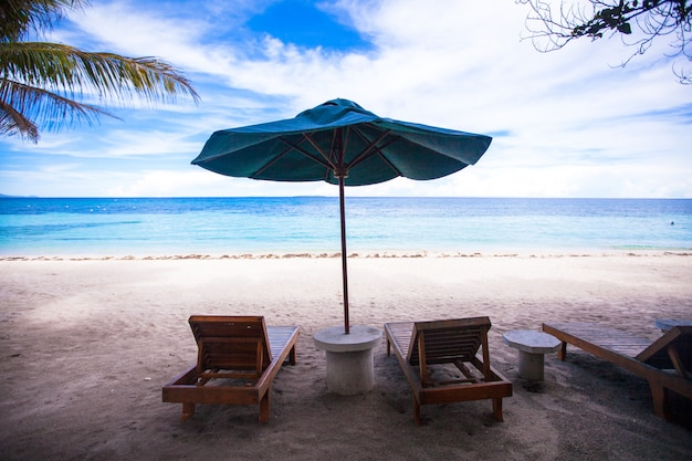 Beach loungers and umbrellas on the exotic resort