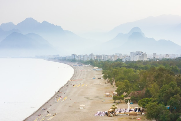 Beach and  mountains on a foggy day