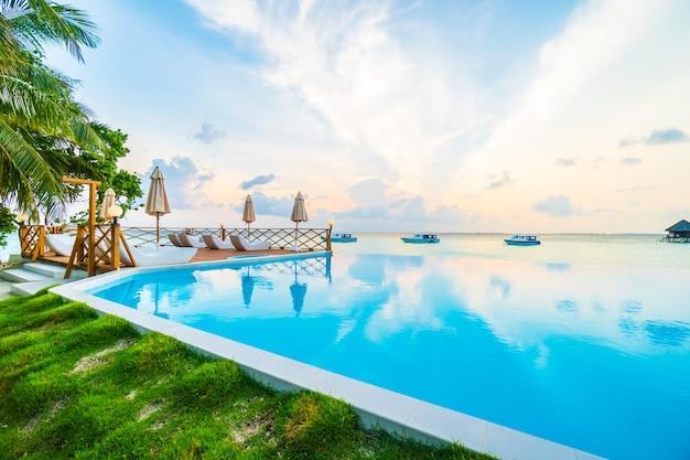 Beach palm blue sky infinity