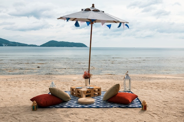 Beach picnic to drink and eat and enjoy seascape view in phuket, thailand