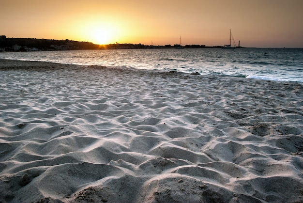 Beach of san vito lo capo at sunset, sicily