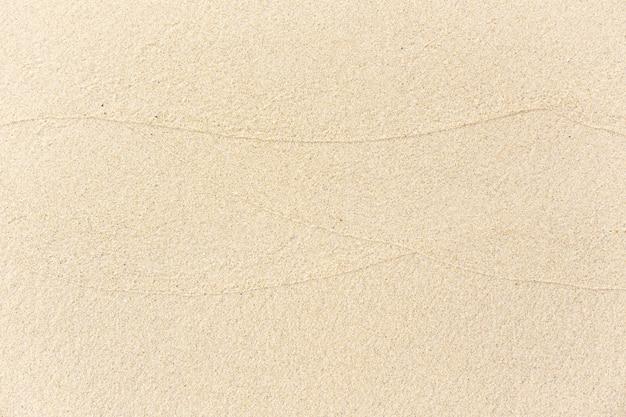 Текстура предпосылки песка пляжа. мокрый песчаный пляж