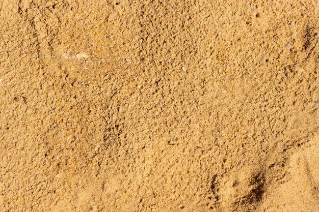 Концепция предпосылки текстуры песка пляжа.