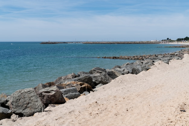 Beach sand with rocks in island of noirmoutier in vendee france
