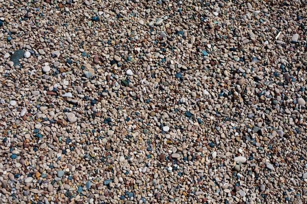 Пляж песчаный и каменистый фон