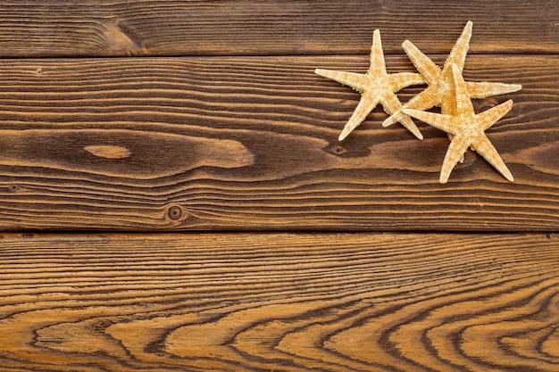 Beach stars on wooden background