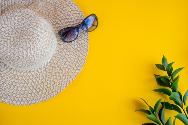 Beach summer travel flat lay sun glasses and woman hat ,top view tourist traveler or vacation concep