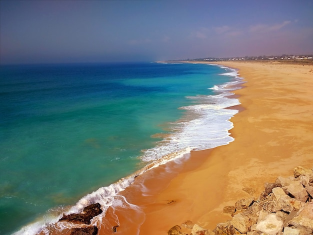 Beach surrounded by the sea under the sunlight in cadiz, spain