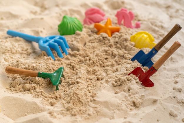 Beach toys on sand in summer.