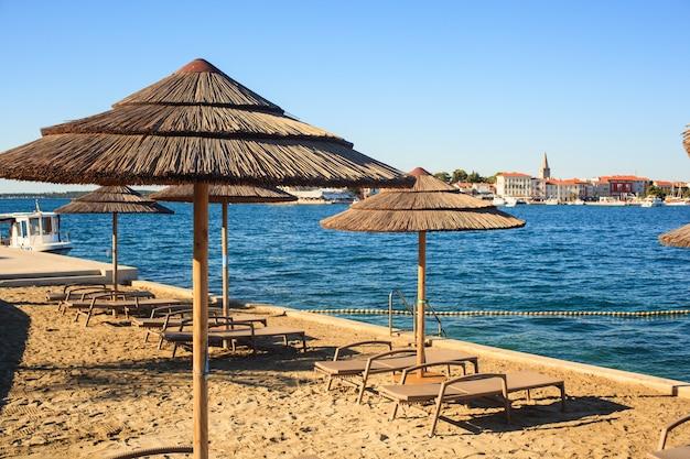 Beach umbrellas in saint nicholas island, porec
