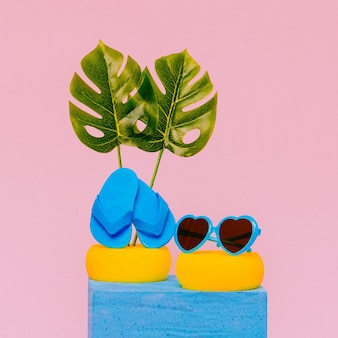 Beach vacation mood. sunglasses and flip-flop  vacation minimal cocept