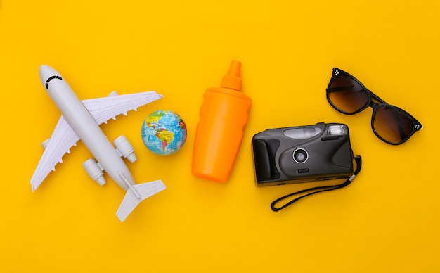 Beach vacation, travel flat lay. travel accessories top view on yellow