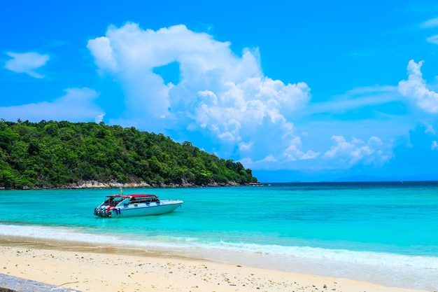 The beach view with speed boat for day trip to koh racha yai island in phuket, thailand