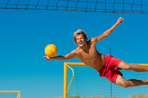 Beach volleyball - man jumping