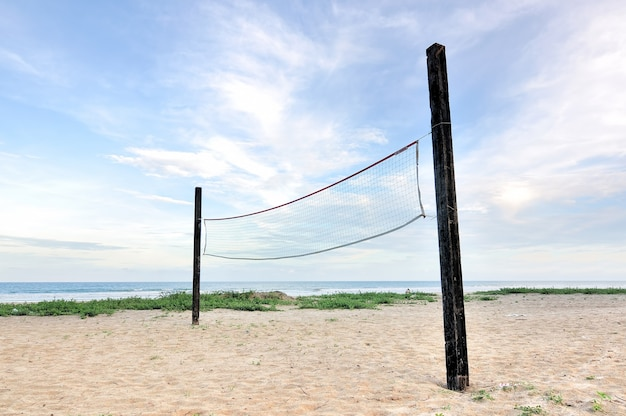 A beach volleyball net on a sunny day