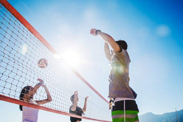 Beach volleyball scene with bokeh effect