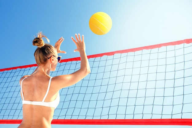 Beach volleyball. woman with ball.