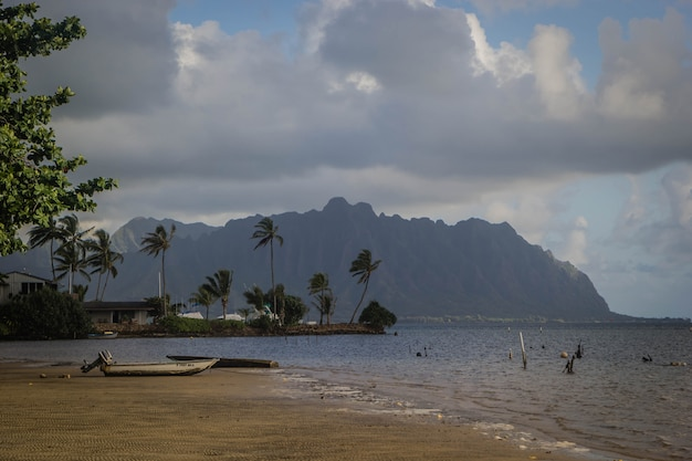 Beach of waimanalo during misty weather with breathtaking large grey clouds in the sky