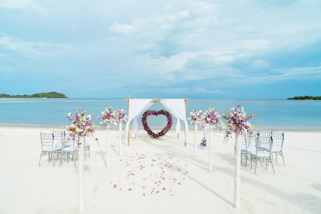 Beach wedding venue setting with roses flower decoration