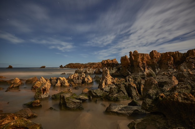 Beach with rocks in playa de ris, noja, spain