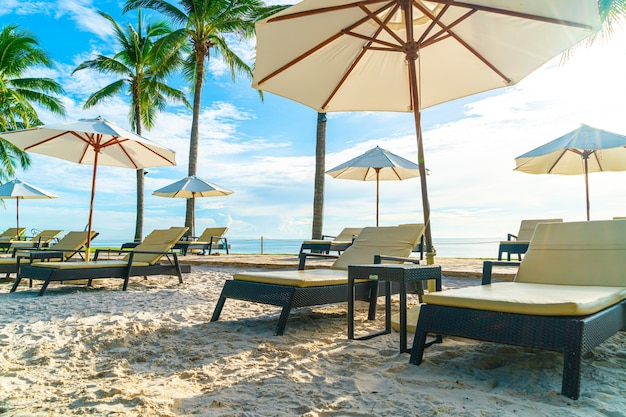 Beach with sun beds and umbrellas