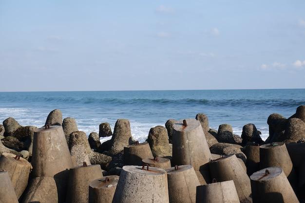 Beach with wave breaker concrete