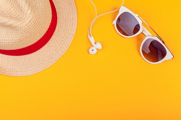 Beach woman's hat sun glasses top view