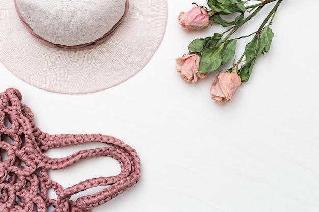 Beach woman's hat with wide flaps from cotton and pink knitted bag
